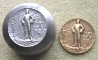 Early 20th century steel medal die from a design by Felix Rasumny, with bronze medal